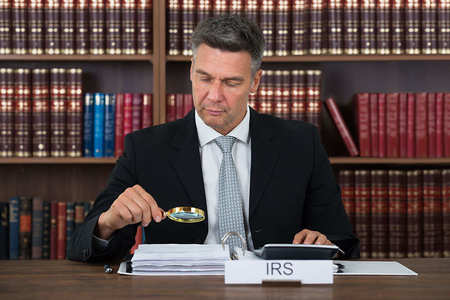 an irs auditor checking tax returns
